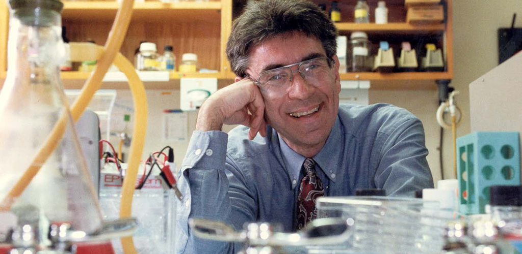Dr. Robert Lefkowitz, smiling in his lab.