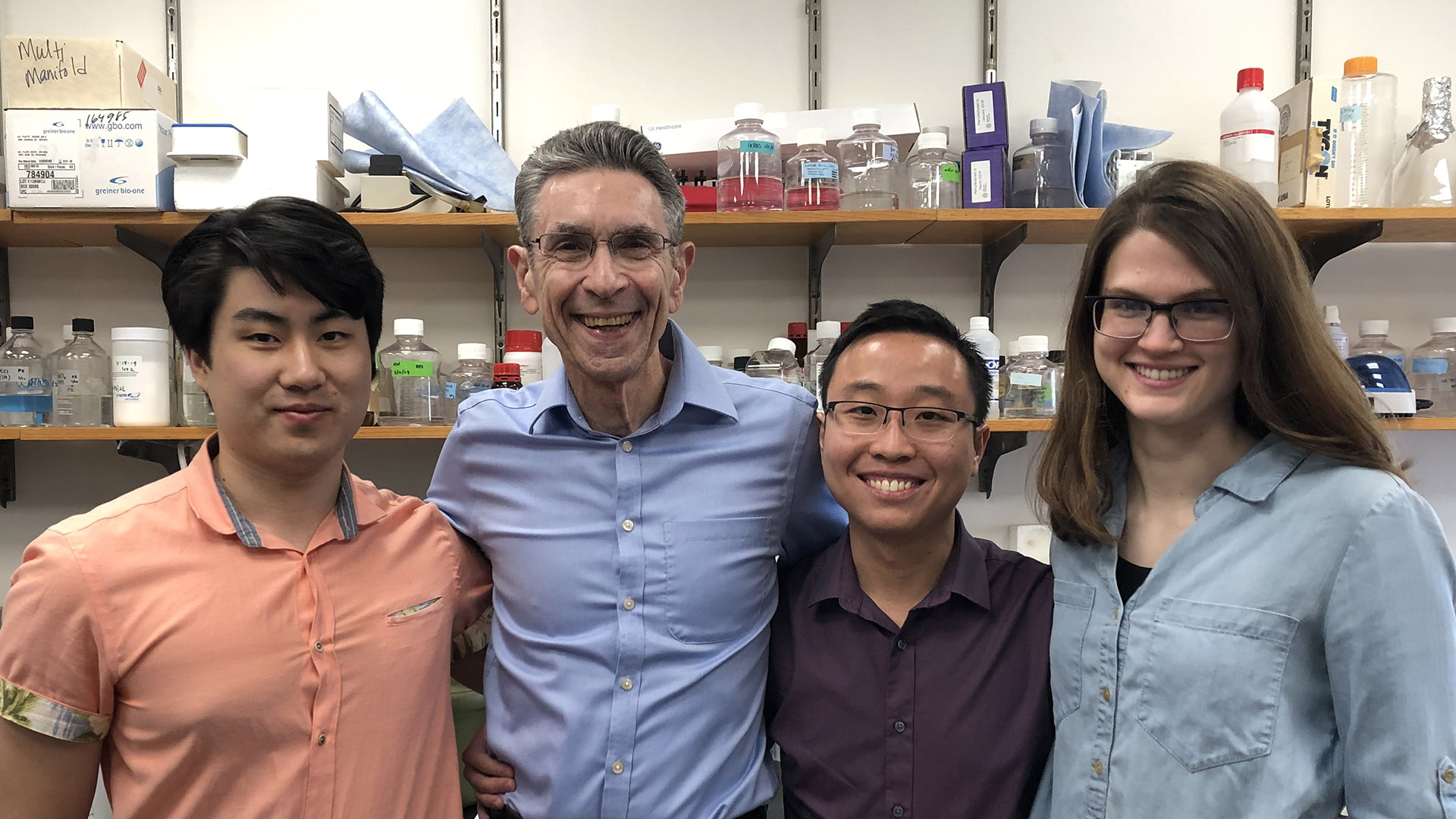 Dr. Robert Lefkowitz in his lab with his young colleagues.